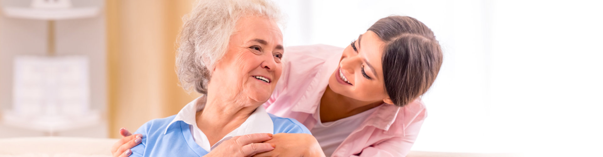 old woman and her caregiver looking to her