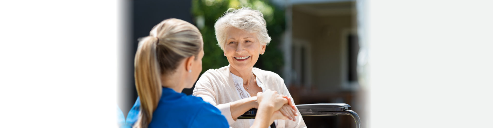 woman talking to senior woman